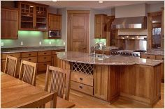 Lake Country Construction Palmberg Home Balsam Lake, WI Kitchen Cabinetry, Chairs and Table Quarter Sawn Oak (stained)