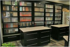 Department of Interiors Office Space Eau Claire, WI Office / Retail Built in Storage, Displays Maple (Stained)